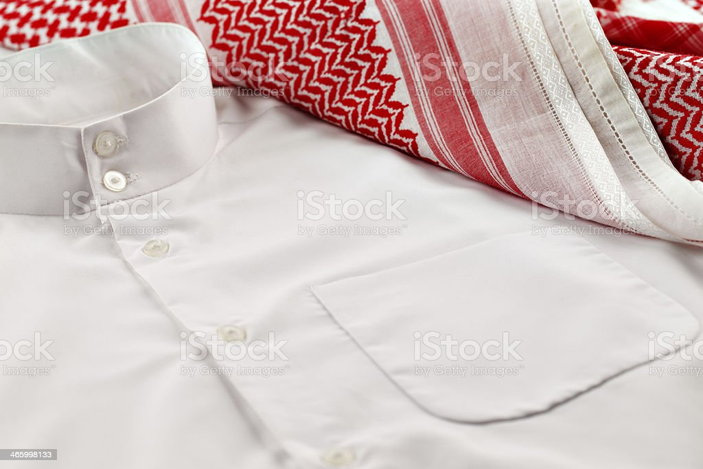 Kandura and Ghutrah are worn by men in Arab Countries stock photo