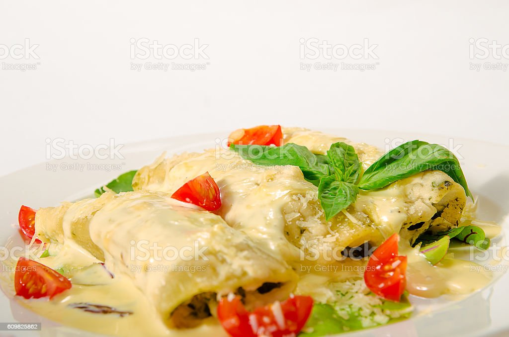 Kaneloni with bacon, chicken, cream cheese and bechamel sauce un stock photo
