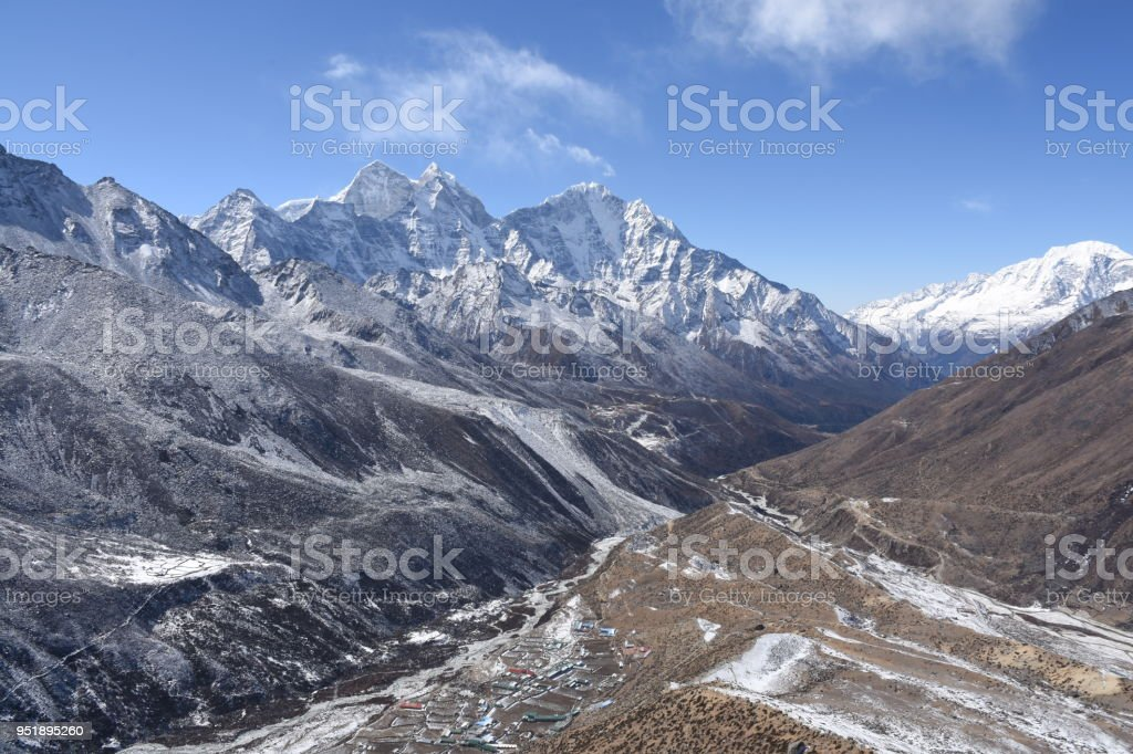 Kangtega and Dingboche photographed from Nangkartshang, Nepal stock photo