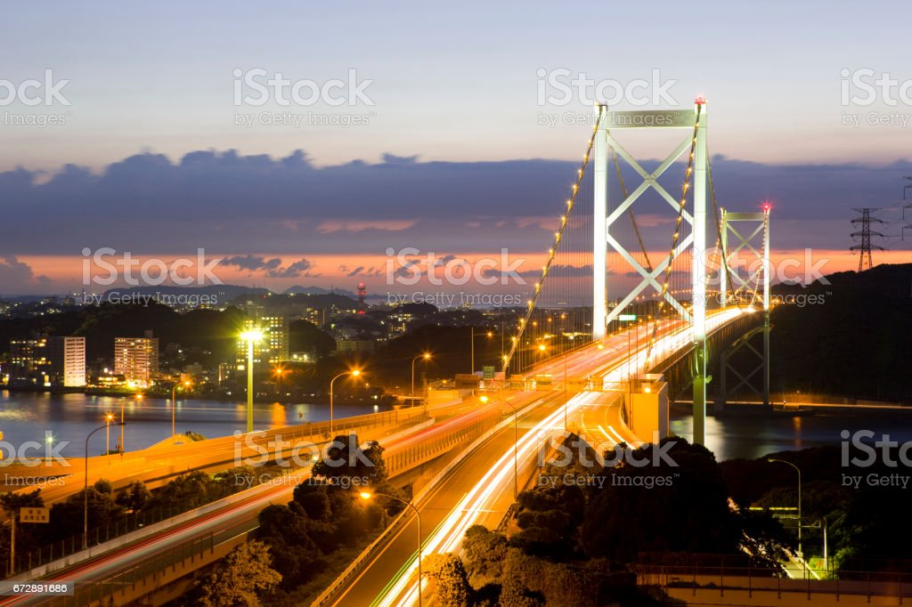 Kanmon bridge and automobile road sunset stock photo