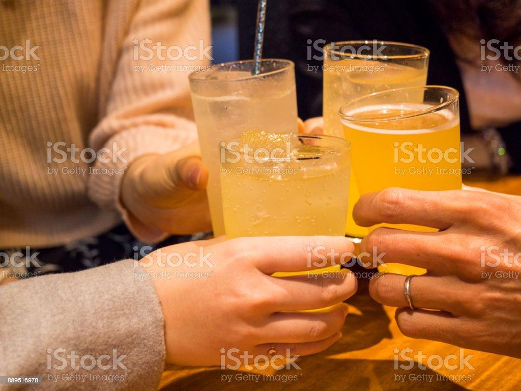 Kanpai - start dringing at the party. stock photo