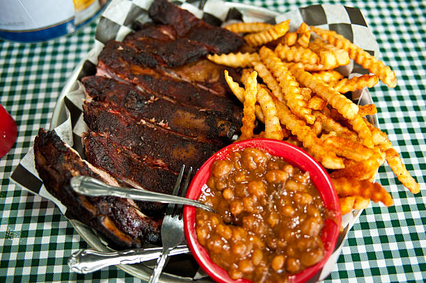 Kansas City barbecue ribs with fries and baked beans stock photo
