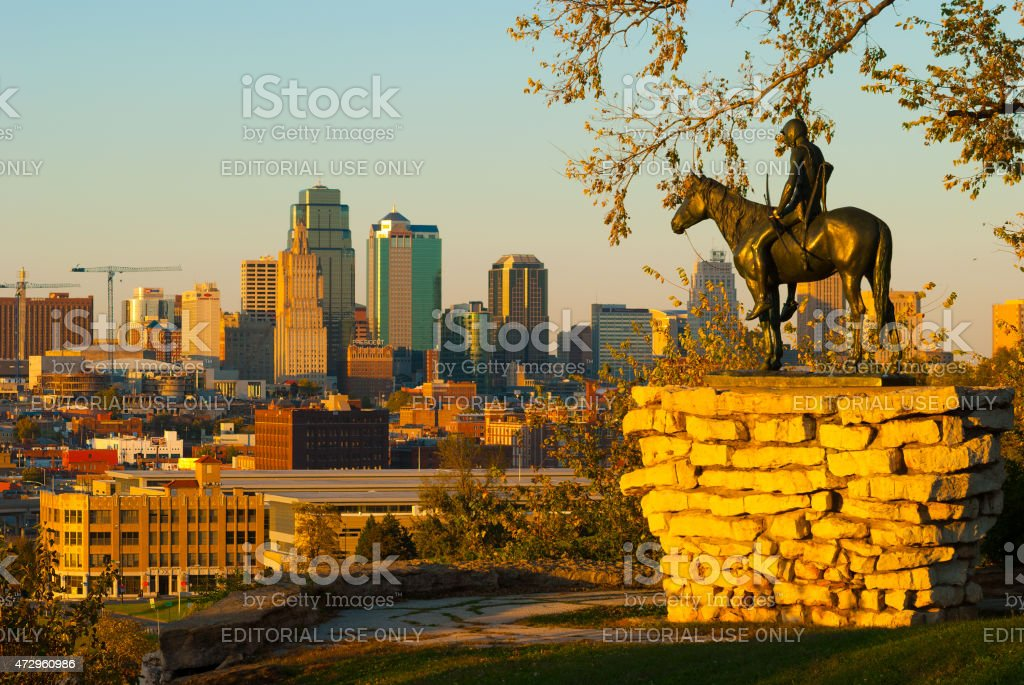 Kansas City skyline and the Scout Statue during the golden hour stock photo