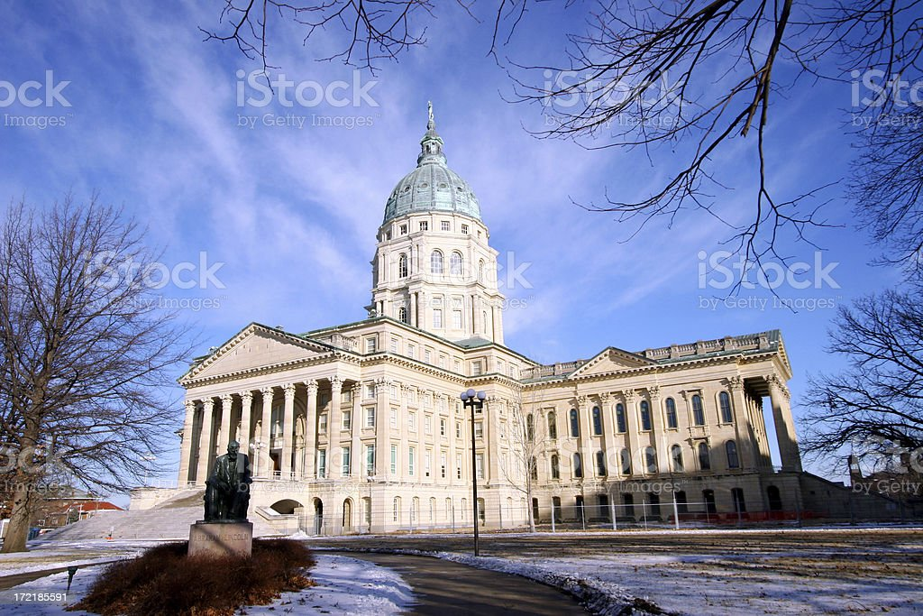 Kansas state capitol in trees stock photo