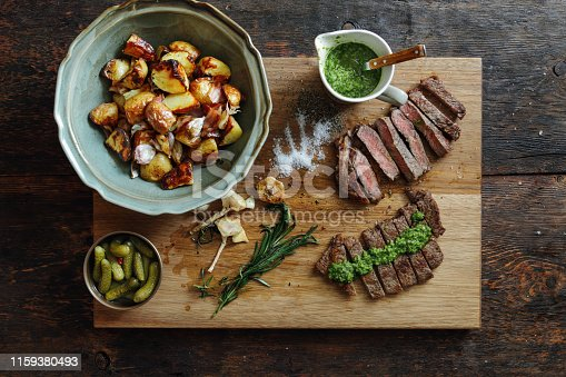 808351106 istock photo Kansas steak with fresh herb sauce and grilled vegetables 1159380493