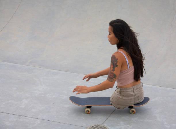 Kanya Sesser skateboarding at Venice stock photo