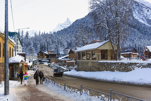 Karachay Street and bridge over the Amanauz river in the resort village. Winter day