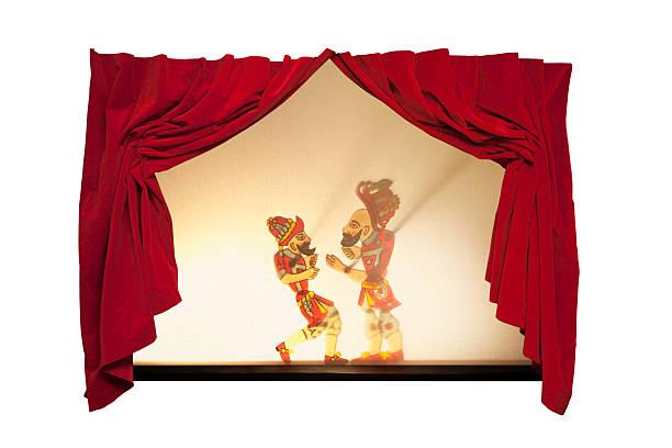 Karagoz and Hacivat on curtain-drawn stage stock photo