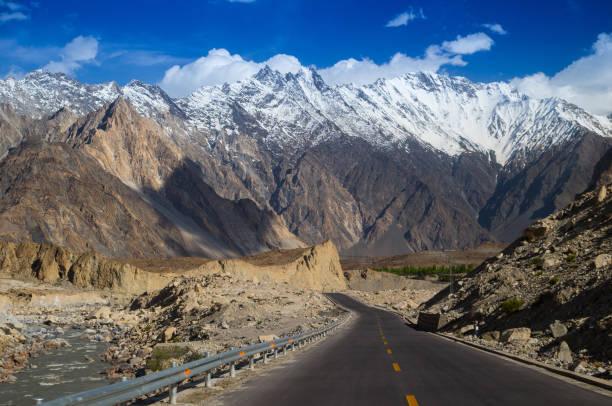 Karakoram Highway with mountain in background stock photo