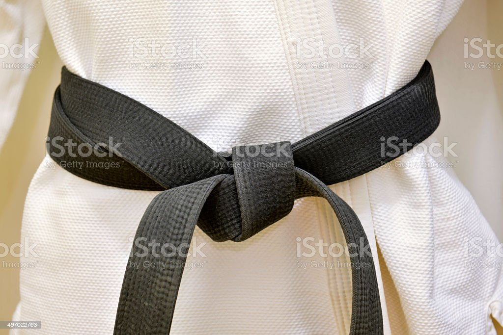 Karate Black Belt on White Uniform stock photo