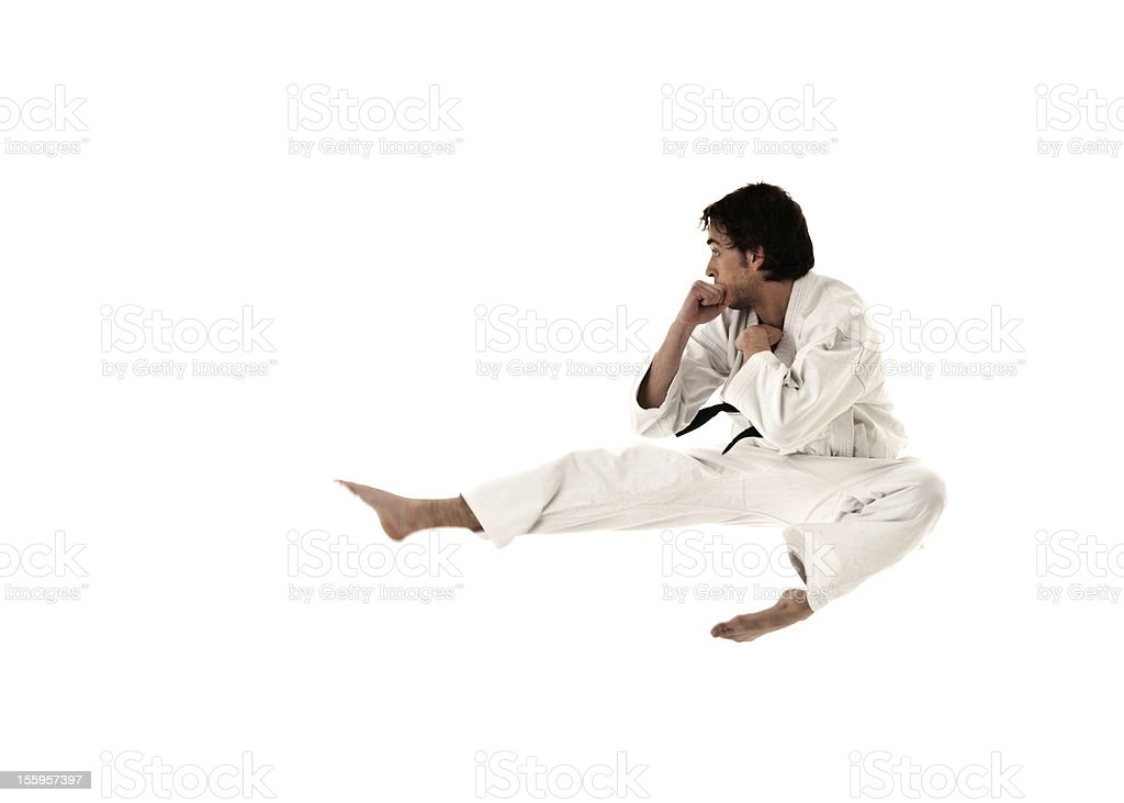 karate flying kick young male fighter isolated on white background. stock photo
