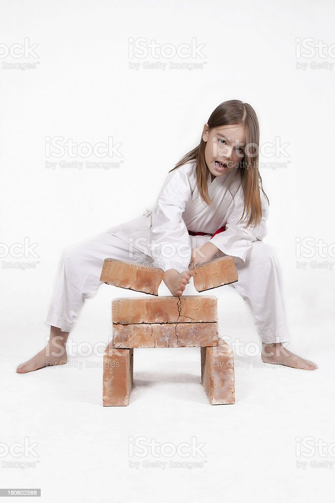 Karate girl breaks bricks 2 stock photo