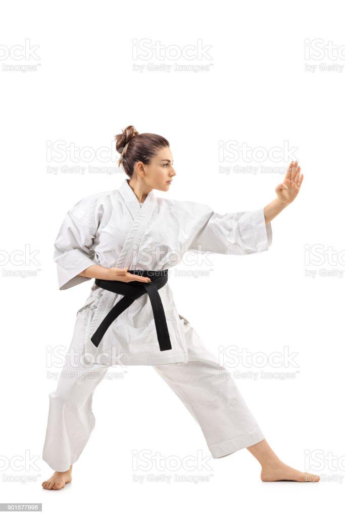 Karate girl doing a kata stock photo