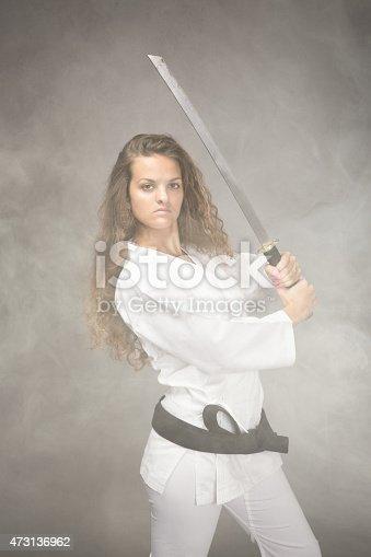 497607484 istock photo karate girl in a cloud of fog 473136962