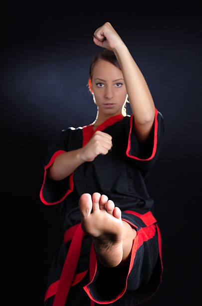 karate girl in kimono - karate stock photos and pictures