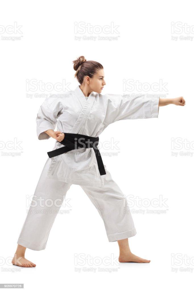 Karate girl punching stock photo