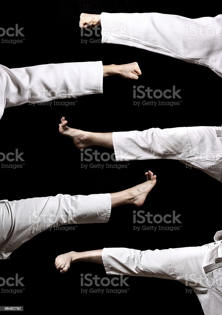 Karate. Hands and legs royalty-free stock photo