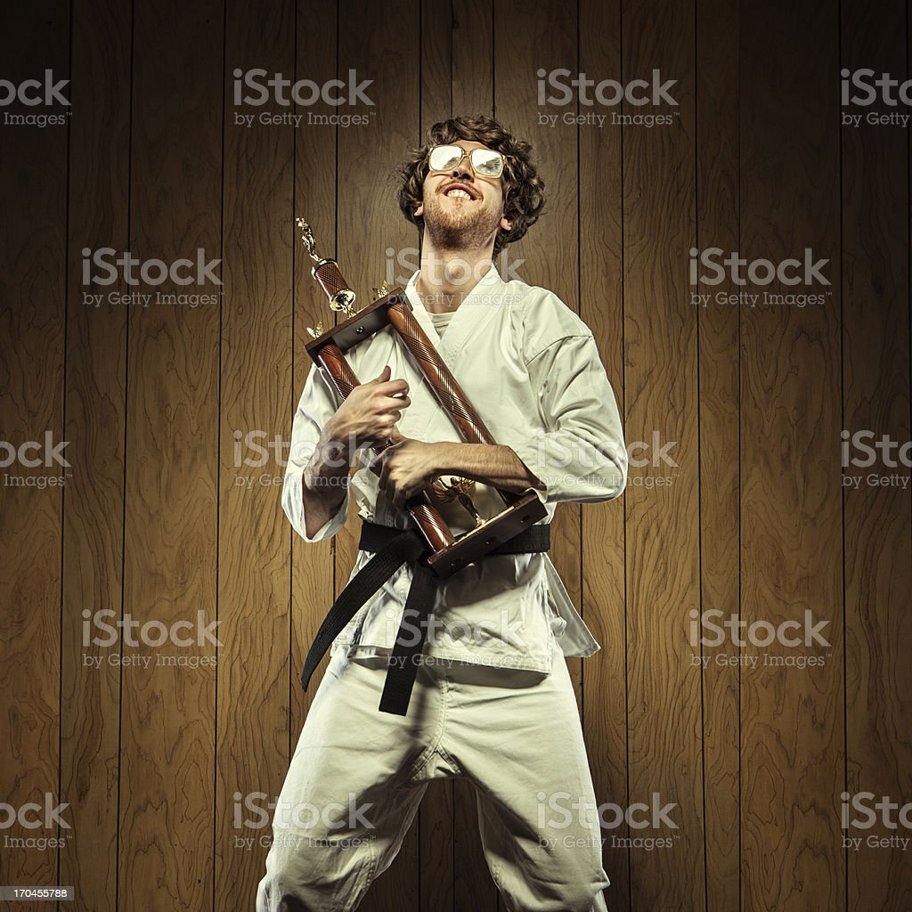Karate Nerd is Proud of His Trophy royalty-free stock photo