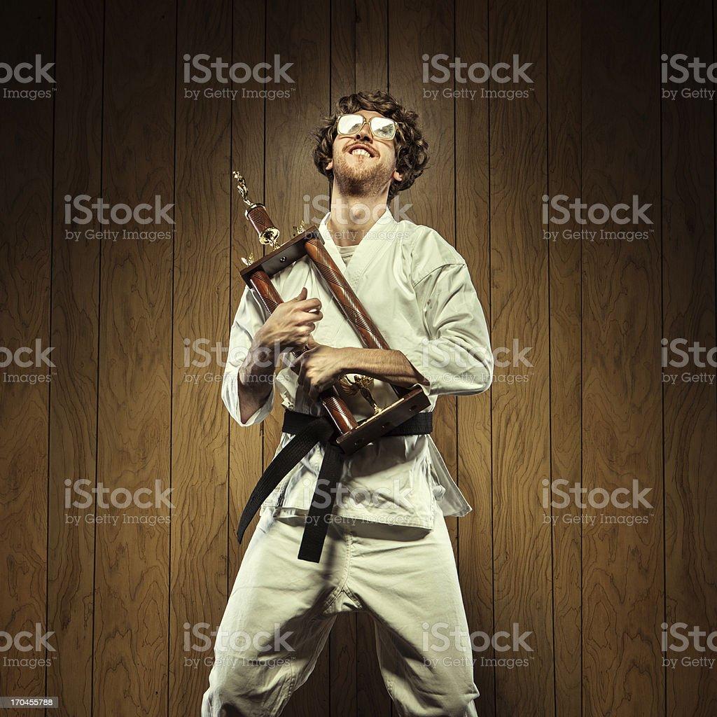Karate Nerd is Proud of His Trophy stock photo