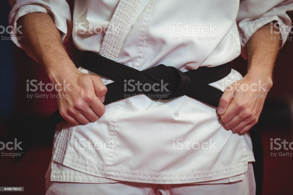 Karate player in black belt stock photo
