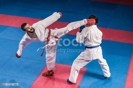 Male karate players fighting during the competition.