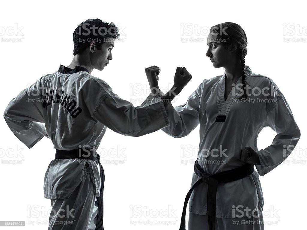 karate taekwondo martial arts man woman couple silhouette royalty-free stock photo