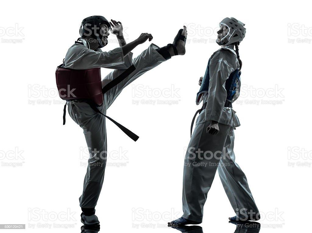 karate taekwondo martial arts man woman couple silhouette stock photo