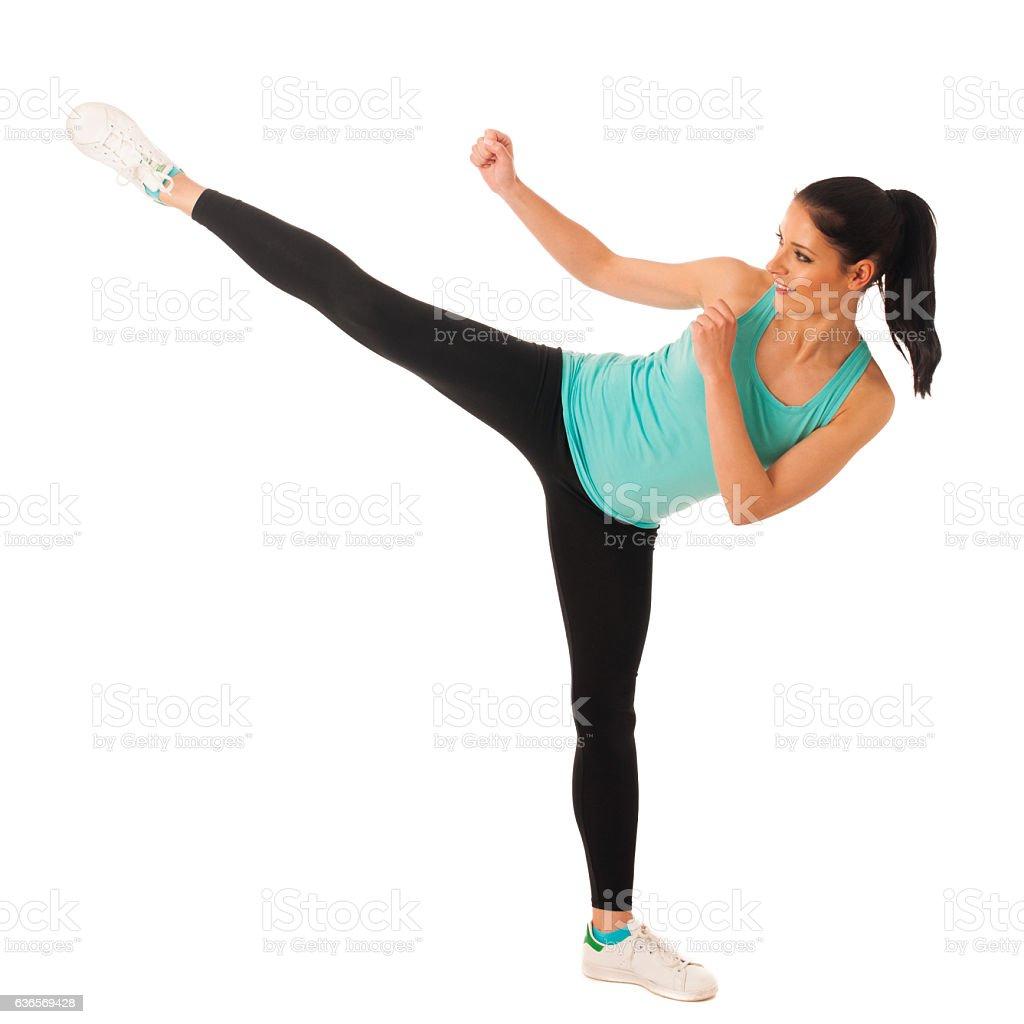 Karate woman kicks in copy space