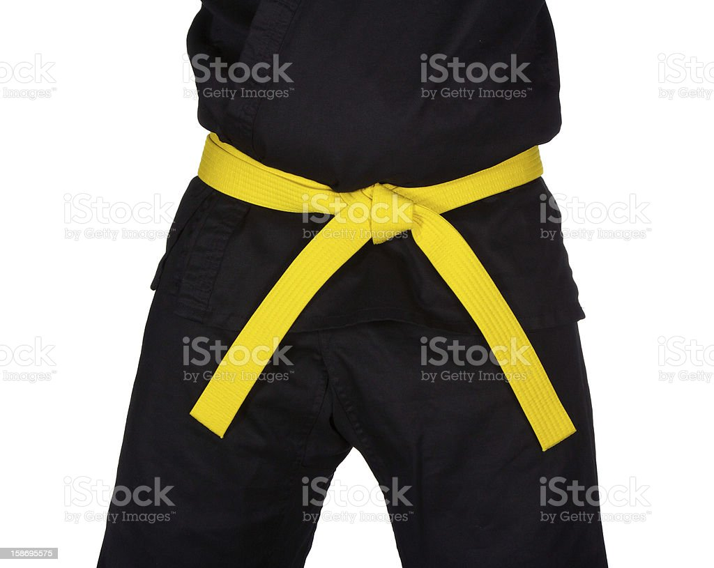 Karate Yellow Belt Tied Around Torso Black Uniform royalty-free stock photo
