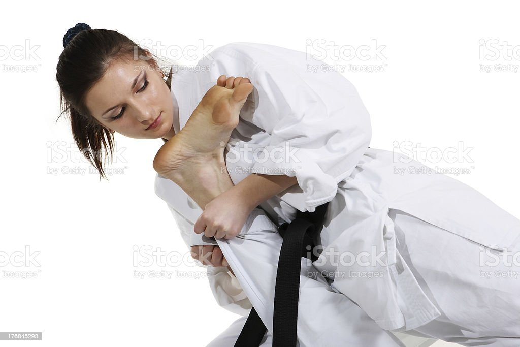 Karate. Young girl in a kimono royalty-free stock photo