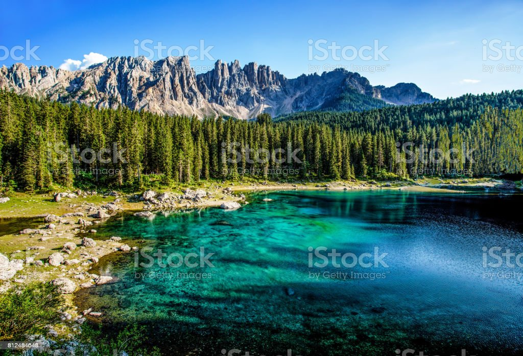 Karersee (Lago di Carezza), is a lake in the Dolomites in South Tyrol, Italy.In the background the mountain range of the Latemar group, Dolomites stock photo