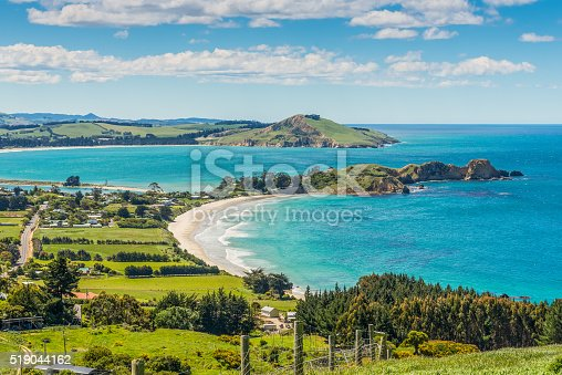 Karitane coastline, Huriawa Peninsula in the center (Historic Maori Pa Site), Karitane near Dunedin Otago South Island New Zealand
