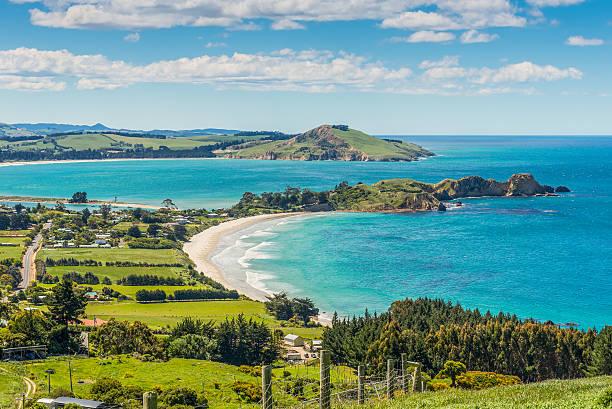 Karitane coastline, Otago, South Island, New Zealand Karitane coastline, Huriawa Peninsula in the center (Historic Maori Pa Site), Karitane near Dunedin Otago South Island New Zealand headland stock pictures, royalty-free photos & images
