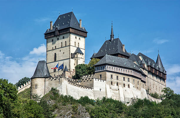 Karlstejn is a large gothic castle founded 1348 스톡 사진