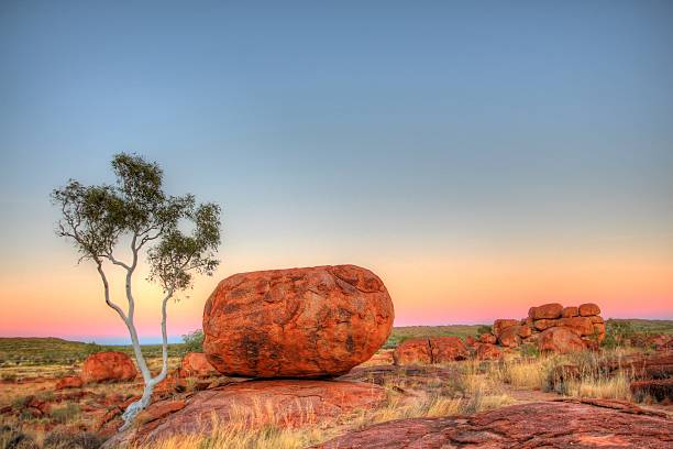 Karlu Karlu - Devils Marbles in outback Australia Granite boulders in Australian bush. outback stock pictures, royalty-free photos & images