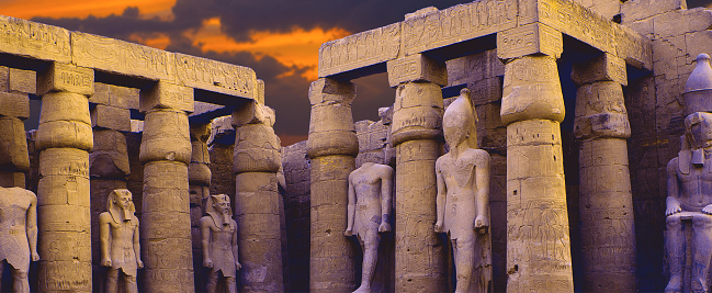 istock Karnak Temple, Colossal sculptures of ancient Egypt in the Nile Valley in Luxor,  Embossed hieroglyphs on the wall 1161944194