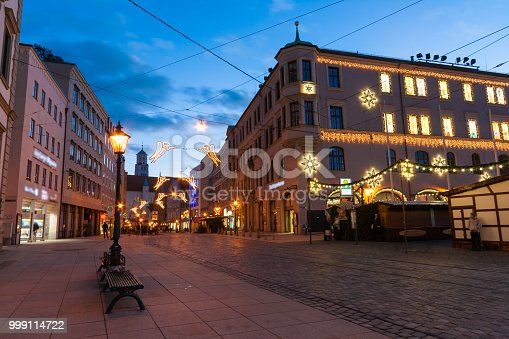 istock Karolinenstrasse in Augsburg, Germany, during the blue hour in winter 999114722