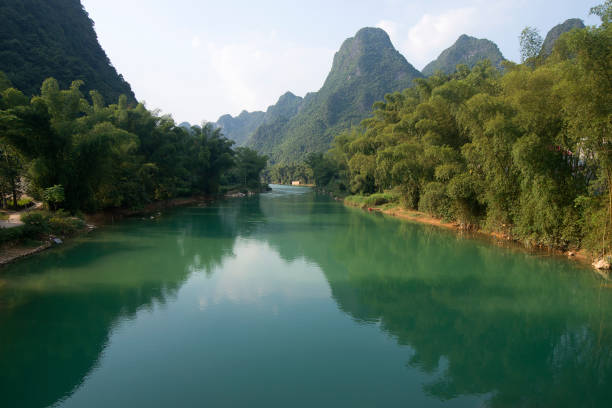 Karst mountains and green river stock photo