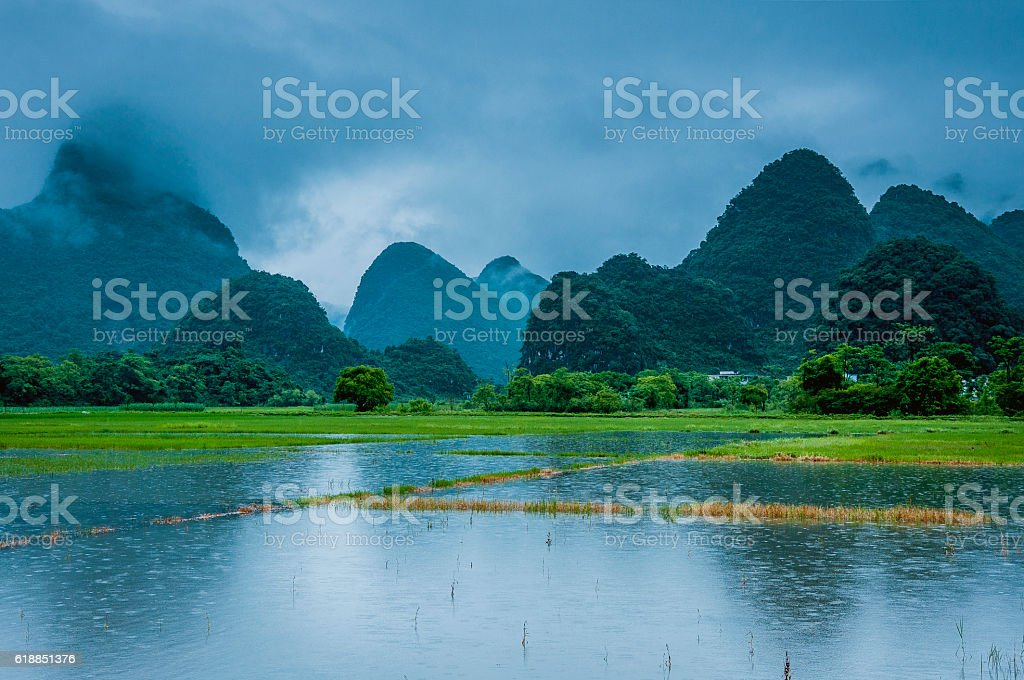 Karst mountains and rural scenery in the mist stock photo