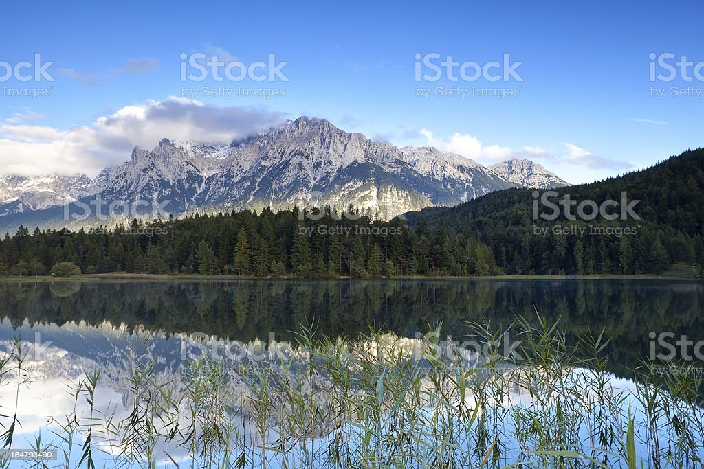 Karwendel mountain range reflected in Lautersee lake stock photo