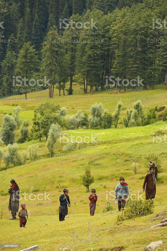 Kashmir Gypsy Goatherders Walking Hill royalty-free stock photo