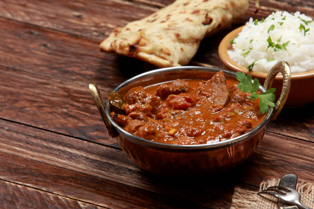 Kashmiri Rogan Josh Indian Cuisine Kashmiri Rogan Josh - Lamb Filet marinated with herbs and spices served with Basmati Rice and Garlic Naan Bread making a delightful tender and spicy meal. garam masala stock pictures, royalty-free photos & images