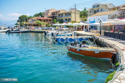 Colorful port with fishing boat and nets in Kassiopi on Corfu island, in Greece