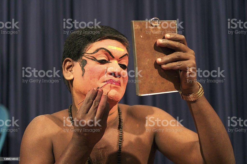 Kathakali actor prepares for show stock photo