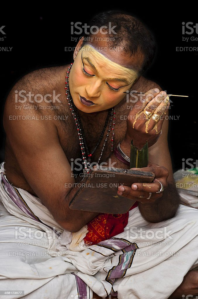 Kathakali, dancer putting on make-up, Kannur, Kerala, India stock photo