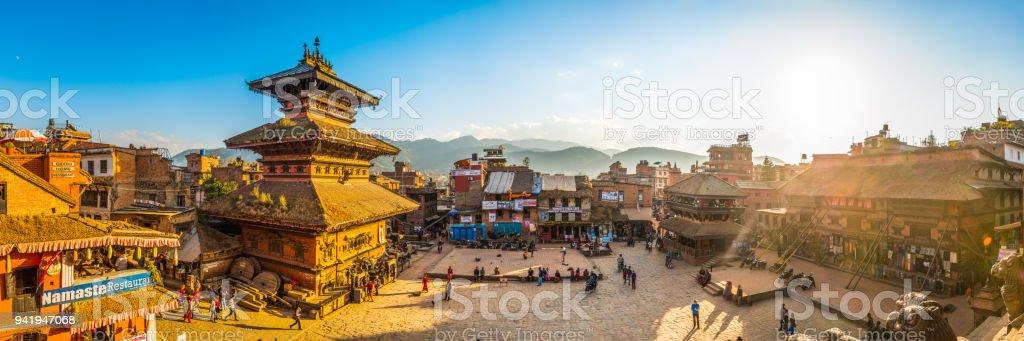 Kathmandu ancient temples illuminated by golden sunset panorama Bhaktapur Nepal stock photo