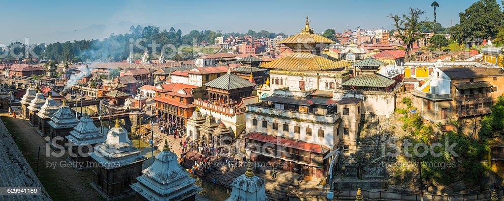 Kathmandu crowds at Pashupatinath Hindu temple funeral ghats panorama Nepal stock photo