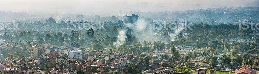 Kathmandu smokey morning mist over crowded rooftops panorama Nepal stock photo