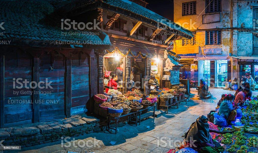 Kathmandu warmly illuminated night market spice sellers Durbar Square Nepal stock photo