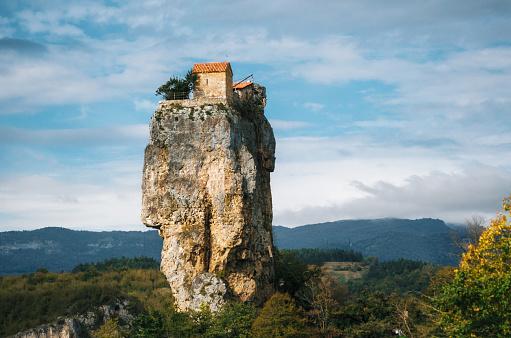 istock Katskhi pillar. Georgian landmarks. The church on a rocky cliff. 625702656